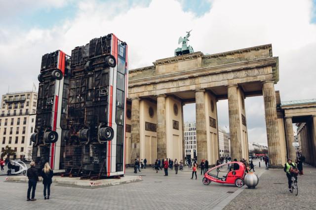 a monument made of buses at brandenburger tor. Black Bedroom Furniture Sets. Home Design Ideas
